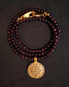colgante northstone garnet oro