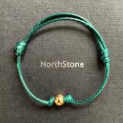 pulsera northstone hilo verde bola oro